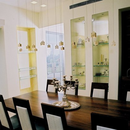 The open dining room - the gilded light ficture by Ultra Lighting