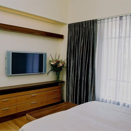 Double layer silk curtains at the master bedrom